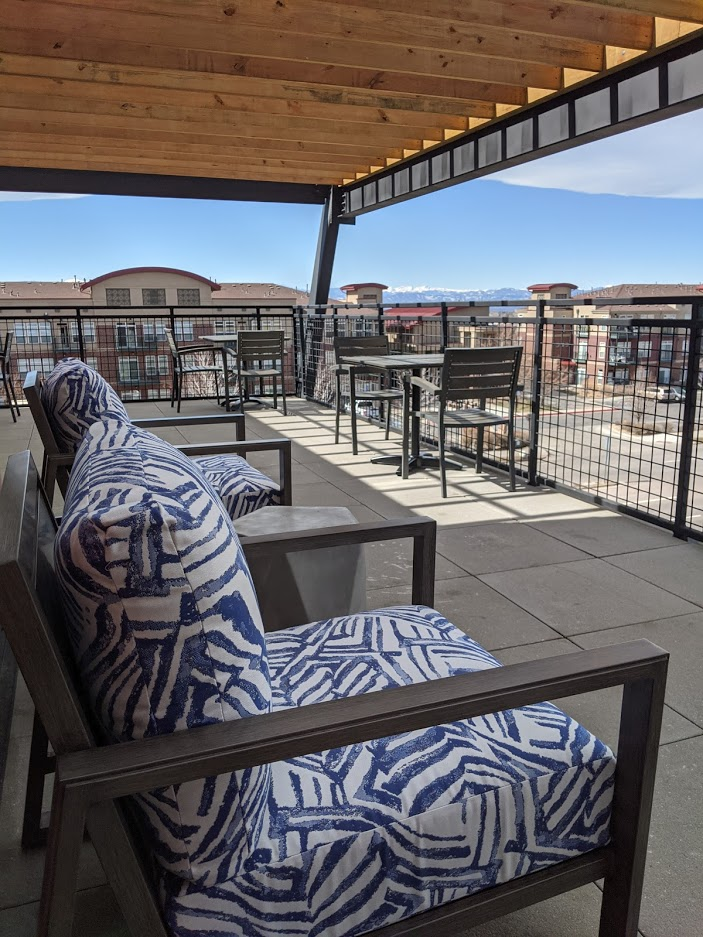 South Denver Coworking space sunny patio with chairs and mountain views